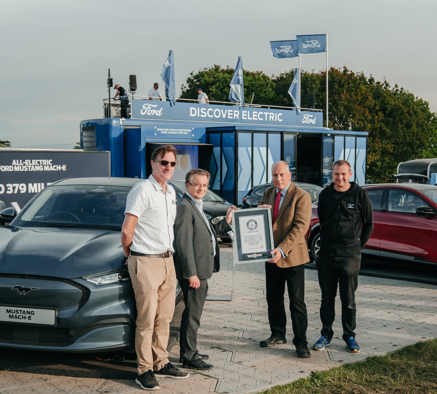 Ford's Tim Nicklin receives record certificate from left to right Mustang Mach-E drivers Fergal McGrath Paul Clifton and Kevin Booker 2